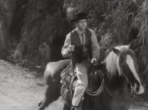 Wagon train man on horseback